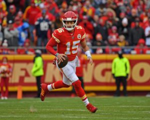KANSAS CITY, MO - DECEMBER 29:  Quarterback Patrick Mahomes #15 of the Kansas City Chiefs rolls out against the Los Angeles Chargers during the first half at Arrowhead Stadium on December 29, 2019 in Kansas City, Missouri. (Photo by Peter G. Aiken/Getty Images)